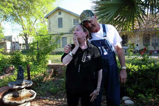 Mimi Montgomery Irwin is moved by the kindness of an unknown neighbor who boarded up her broken windows as neighbor James Pavlicek comforts her Saturday. Authorities have allowed residents in less-devastated areas of West to return. Photo: Mayra Beltran, Staff / © 2013 Houston Chronicle