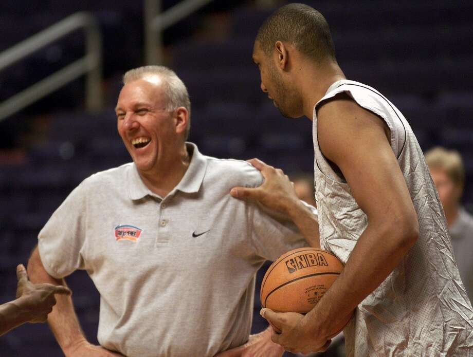 Spurs coach Gregg Popovich laughs as Tim Duncan plays around before the start of Spurs practice Mondat May 1, 2000 at America West Arena in Phoenix Arizona. DELCIA LOPEZ/Express-News Photo: EN