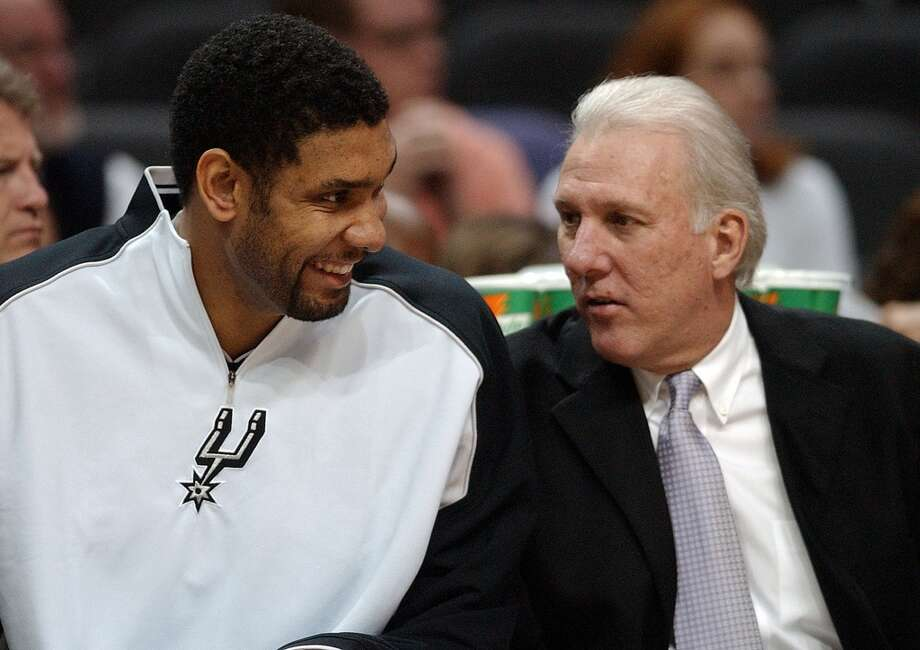 The Spurs\' Tim Duncan talks with coach Gregg Popovich near the end of the game with the Jazz Saturday Nov. 27, 2004 at the SBC Center. The Spurs went on to win 109-76. EDWARD A. ORNELAS/Express-News