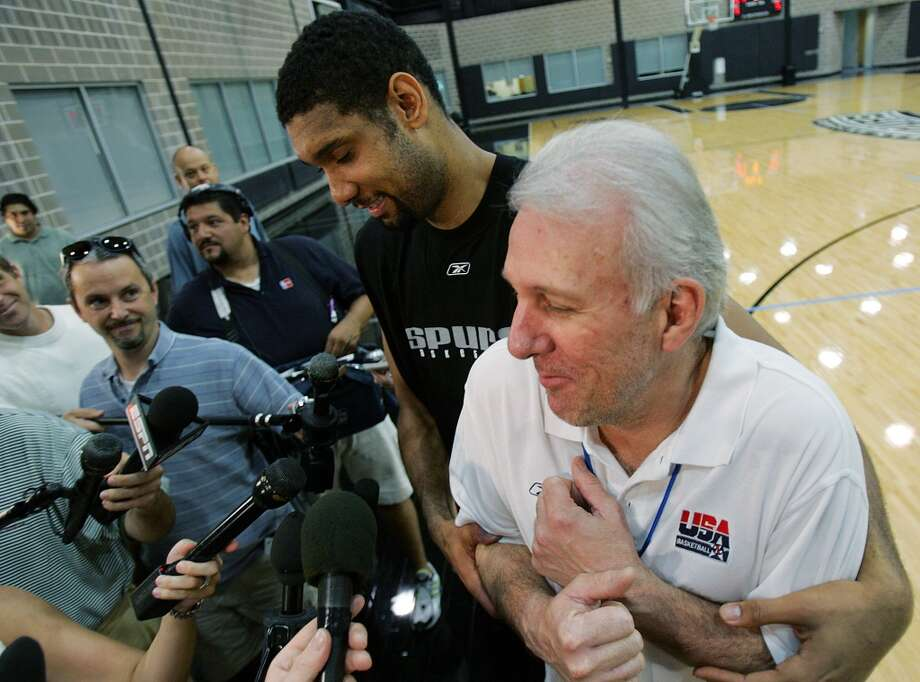 The Spurs' Tim Duncan jokes around with coach Gregg Popovich during media interviews after practice on  June 5,. 2005. The Spurs are in the NBA Finals awaiting the winner of the Detroit Pistons-Miami Heat series. Photo: JERRY LARA, SAN ANTONIO EXPRESS-NEWS