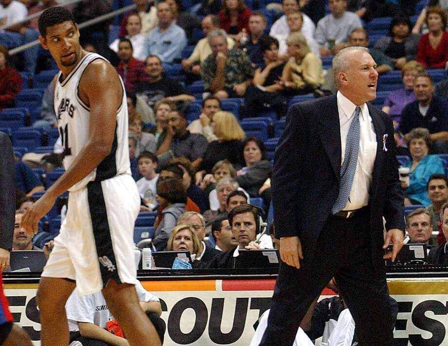 Coach Gregg Popovich, right, reacts Tuesday night Oct. 30, 2001 at the Alamodome after he and Tim Duncan, left, received technical fouls late in the fourth quarter of the Spurs\' 109-98 win over the Clippers in the first game of the NBA regular season.