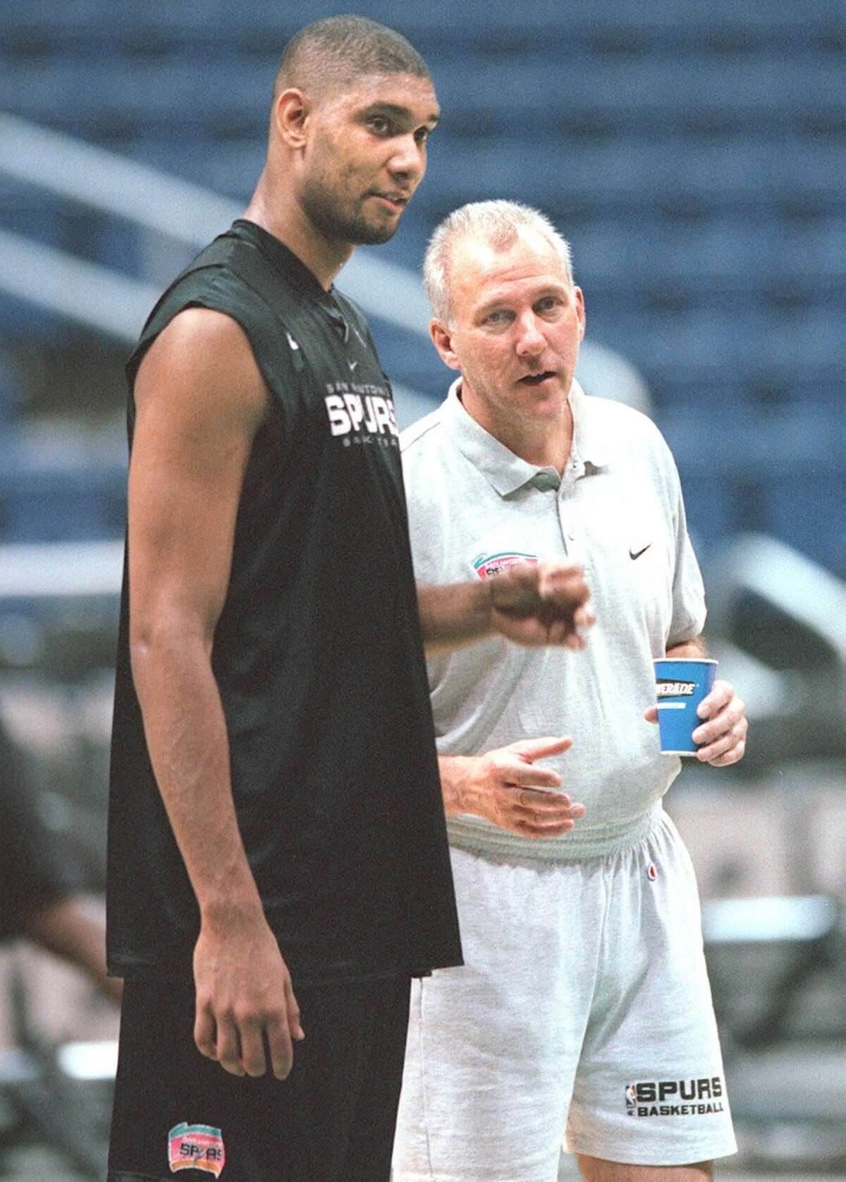 Gregg Popovich talks with Tim Duncan during Spurs practice at the Alamodome on June 9, 1999.