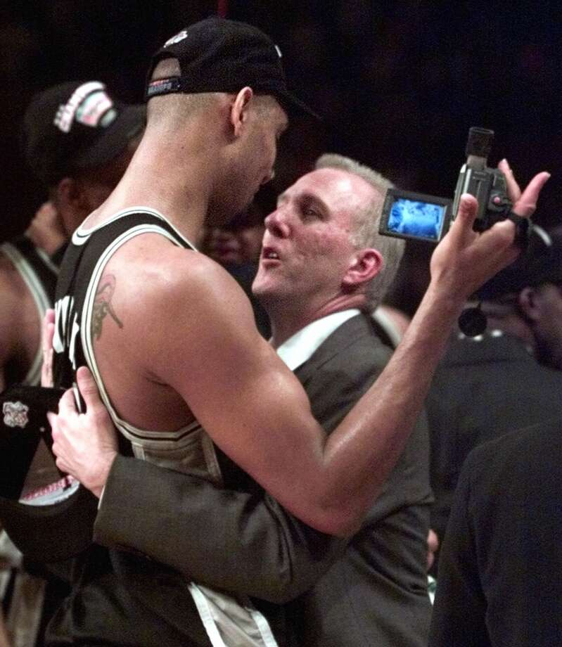 San Antonio Spurs\' Tim Duncan, left, and coach Gregg Popovich celebrate after defeating the New York Knicks 78-77 to clinch the championship in Game 5 of the 1999 NBA Finals Friday, June 25, 1999, at New York\'s Madison Square Garden. (AP Photo/Kathy Willens)