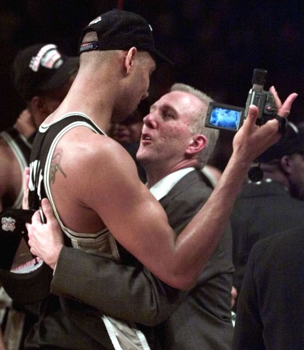 The Spurs' Tim Duncan (left) and coach Gregg Popovich celebrate after defeating the New York Knicks 78-77 to clinch the championship in Game 5 of the NBA Finals on June 25, 1999, at New York's Madison Square Garden.