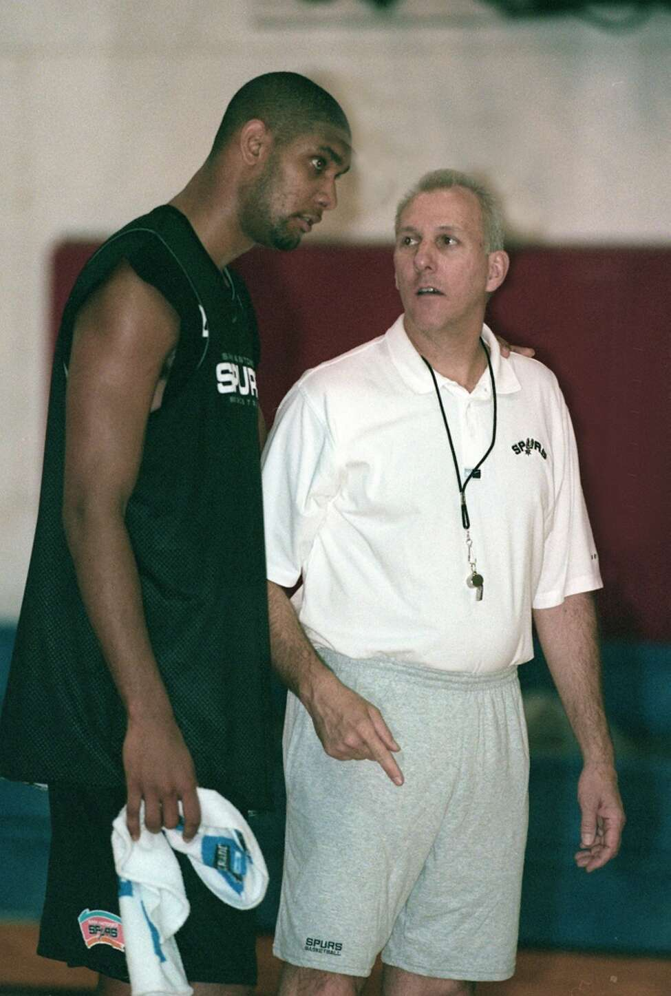 Tim Duncan and Coach Gregg Popovich talk after the first day of training camp for the Spurs, October 2,1999.