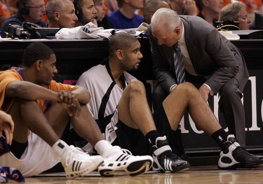 Spurs coach Gregg Popovich talks to Tim Duncan Wednesday night May 16, 2007 in the US Airways Arena in Phoenix as he waits in front of the scorers table to enter the game during the Spurs\' fifth game of their best-of-seven, second-round playoff series against the Suns. WILLIAM LUTHER