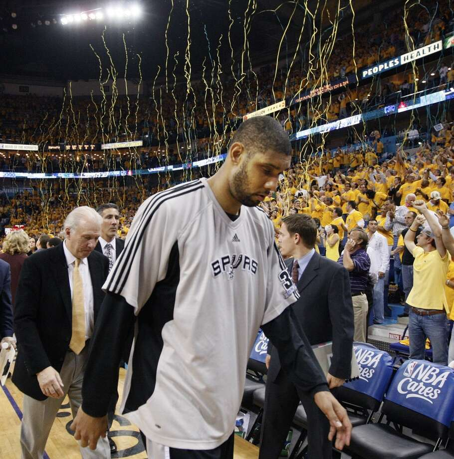 Spurs forward Tim Duncan leads coach Gregg Popovich, left, off the court after losing to the New Orleans Hornets 101-79 in Game 5 of an NBA Western Conference semifinal basketball playoff series Tuesday, May 13, 2008, in New Orleans. (AP Photo/Ann Heisenfelt)