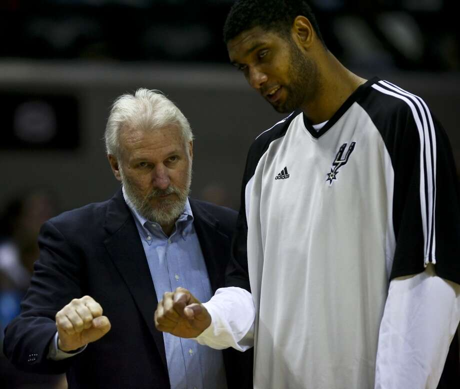 Gregg Popovich and Tim Duncan make hand gestures during a time out in the fourth quarter of their preseason game Oct. 22, 2008 at the AT&T Center. The Spurs lost to the Wizards, 95-100. Photo: BAHRAM MARK SOBHANI, SAN ANTONIO EXPRESS NEWS