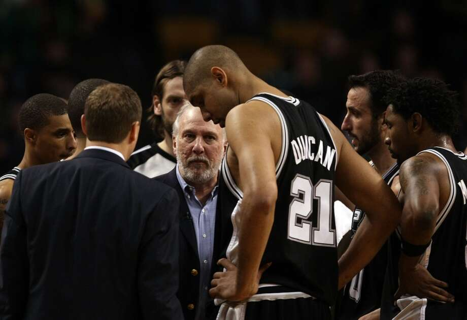 Spurs coach Gregg Popovich talks with his players during a timeout against the Celtics on Feb. 8, 2009 at TD Banknorth Garden in Boston. Photo: Elsa, Getty Images