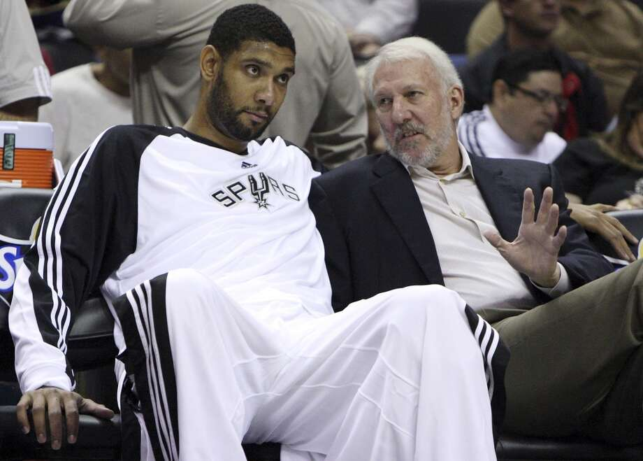 Spurs\' Tim Duncan talks with head coach Gregg Popovich prior to the preseason game with Olympiacos Friday Oct. 9, 2009 at the ATT Center. (PHOTO BY EDWARD A. ORNELAS/Express-News