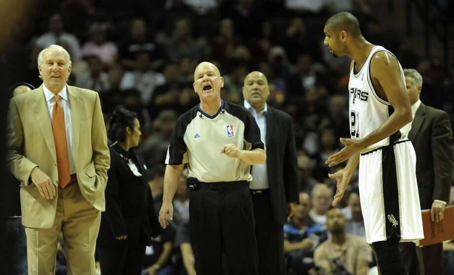 Official Joe Crawford speaks with Spurs coach Gregg Popovich, left, and Tim Duncan during a first-half timeout at the AT&T Center on Thursday, Nov. 19, 2009. BILLY CALZADA/Express-News