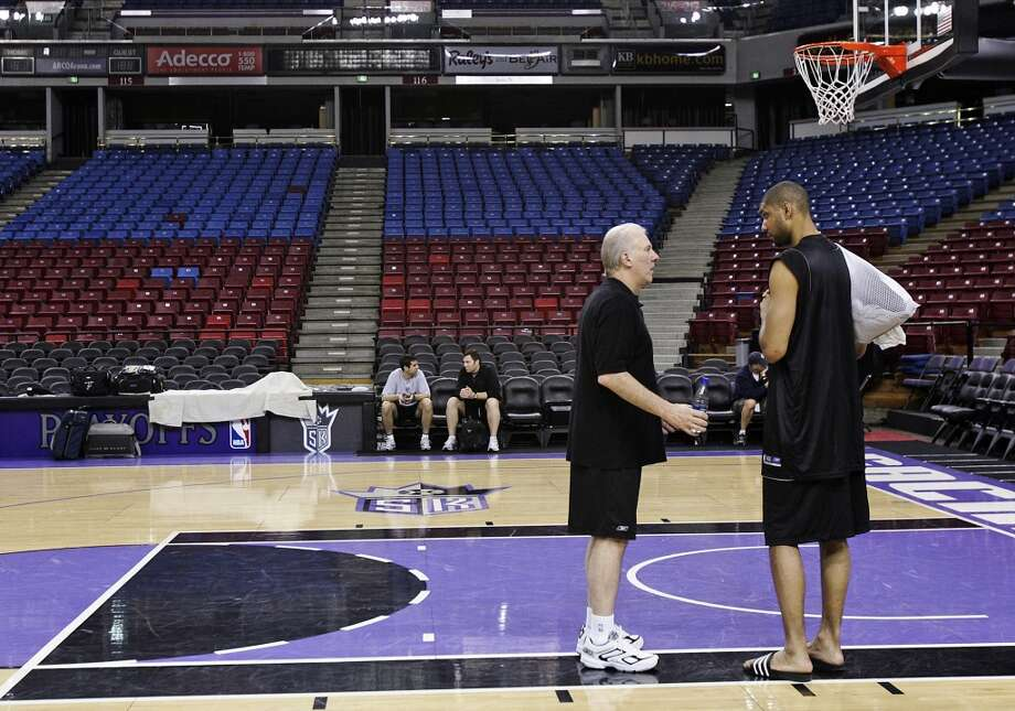 Spurs coach Gregg Popovich (left) talks with star forward Tim Duncan after players attended practice at the Arco Arena on Saturday, April 29, 2006 after losing game 3 the night before to the Sacramento Kings in a last second shot in the first round of the 2006 NBA Western Conference playoffs. Kin Man Hui/Express-News