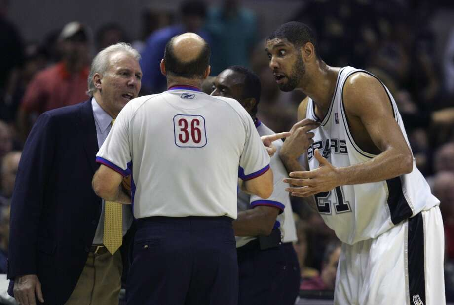 The Spurs\' Gregg Popovich, left, and Tim Duncan talk Tuesday night May 9, 2006 at the AT&T Center to the officials about a call during the second game of their Western Conference Semi-Finals match-up against the Dallas Mavericks. BAHRAM MARK SOBHANI/Express-News