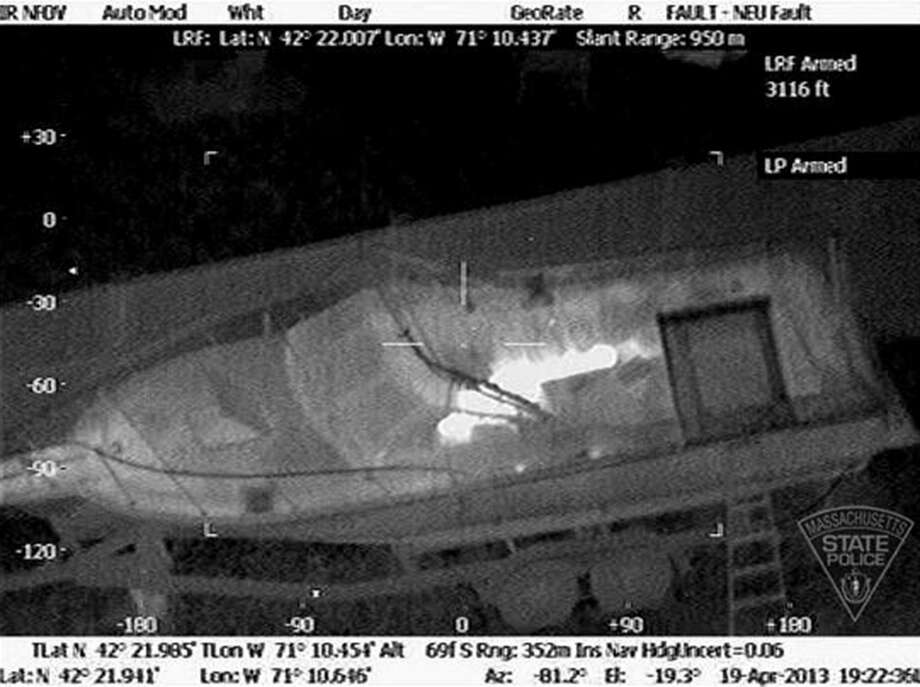 This thermal imaging photo, taken from the air and made available by the Massachusetts State Police, shows 19-year-old Boston Marathon bombing suspect, Dzhokhar Tsarnaev, hiding inside a boat during a search for him in Watertown, Mass. Photo: Massachusetts State Policy Courtesy Photo / Associated Press