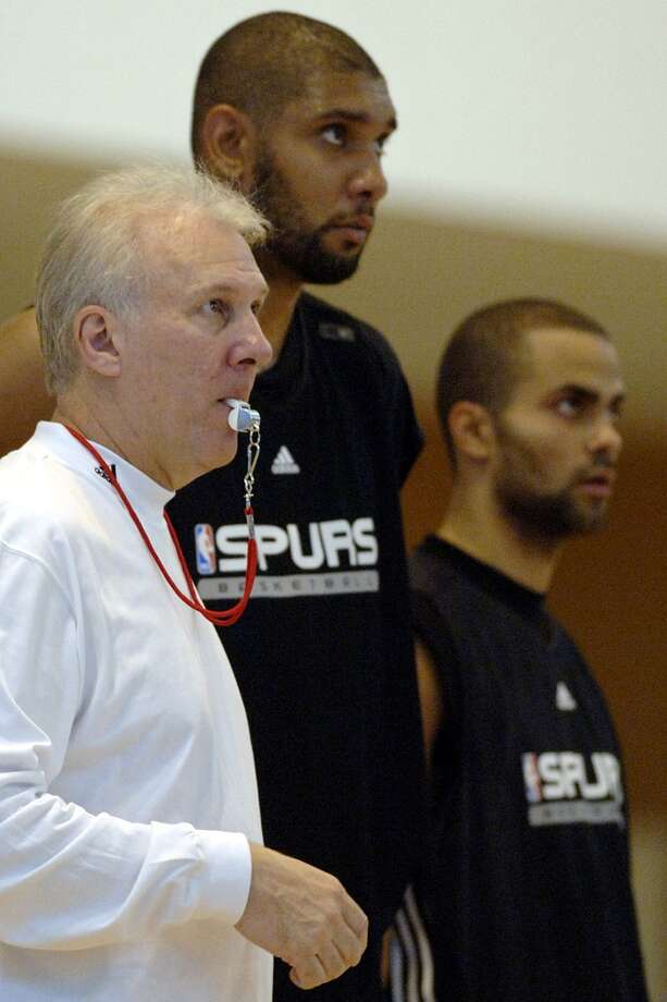 Spurs coach Gregg Popovich, forward Tim Duncan and guard Tony Parker, from left, look on during a team practice session in Lyon, central France, Sunday, Oct. 1, 2006. The Spurs\' first pre-season game is Thursday in Lyon against the French team of Asvel Lyon-Villeurbanne. (AP Photo/Patrick Gardin)