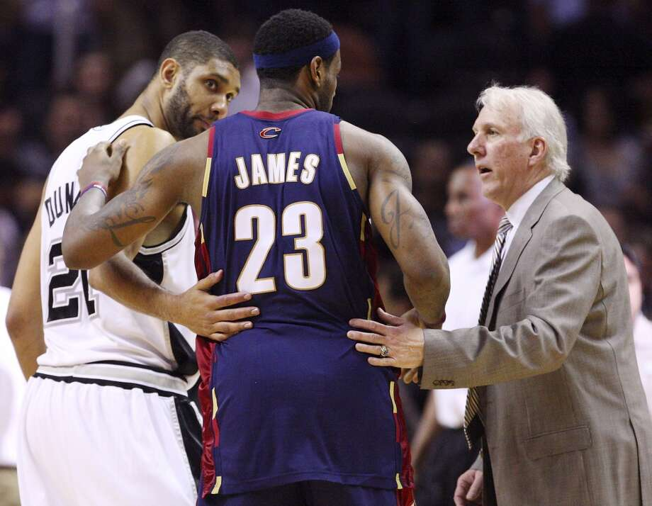 Spurs\' Tim Duncan and coach Gregg Popovich talk with Cavaliers\' LeBron James after the game Friday March 26, 2010 at the AT&T Center. The Spurs won 102-97. EDWARD A. ORNELAS/Express-News
