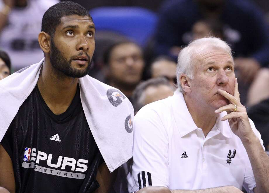 The Spurs' Tim Duncan and coach Gregg Popovich watch the Silver-Black scrimmage Oct. 3, 2010 at the AT&T Center. The Black team won 71-63. Photo: EDWARD A. ORNELAS, SAN ANTONIO EXPRESS-NEWS