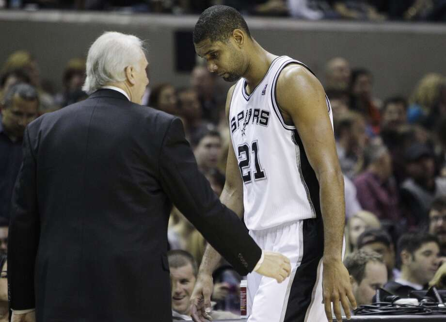 Spurs coach Gregg Popovich, left, talks with Tim Duncan as he walks off the court during the third quarter of an NBA basketball game against the Dallas Mavericks, Friday, Nov. 26, 2010, in San Antonio. Dallas won 103-94, ending the Spurs winning streak at 12. (AP Photo/Eric Gay)
