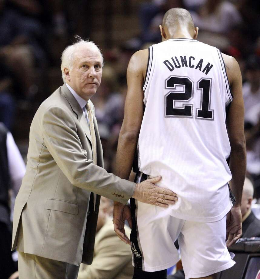 Spurs\' head coach Gregg Popovich pats San Antonio Spurs\' Tim Duncan as he heads to the bench during first half action of game one in the NBA Western Conference First Round against the Memphis Grizzlies at the AT&T Center Sunday April 17, 2011. EDWARD A. ORNELAS/Express-News