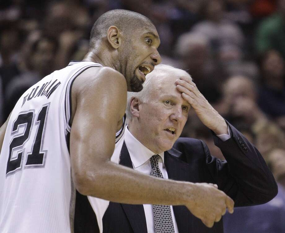 Spurs\' Tim Duncan (21) talks with Spurs coach Gregg Popovich, right, during the fourth quarter of Game 2 of a first-round NBA basketball playoff series against the Memphis Grizzlies, Wednesday, April 20, 2011, in San Antonio. (AP Photo/Eric Gay)