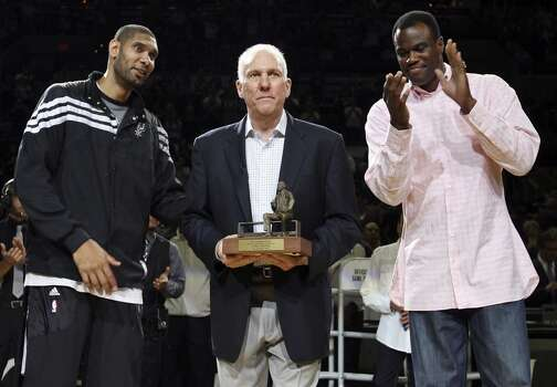 Spurs coach Gregg Popovich holds the Red Auerbach trophy as Tim Duncan and David Robinson look on before Game 2 of the Western Conference first round against the Utah Jazz Wednesday May 2, 2012 at the AT&T Center.