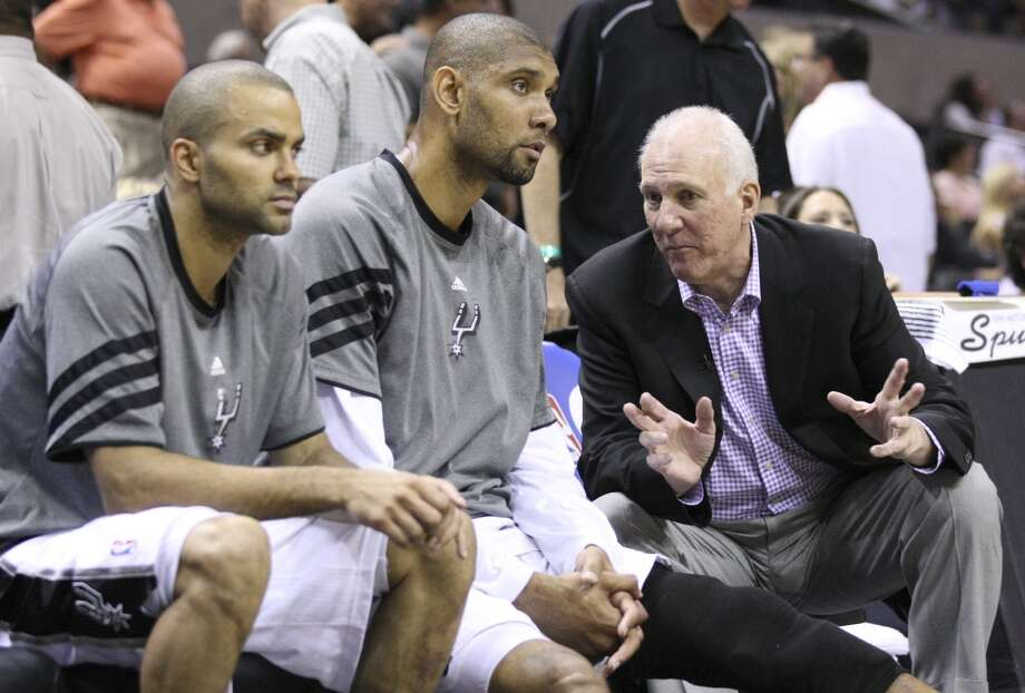 Spurs coach Gregg Popovich talks to Tim Duncan (21) and San Antonio Spurs\' Tony Parker (9) during the second half of game two of the NBA Western Conference Finals in San Antonio, Texas on Tuesday, May 29, 2012.