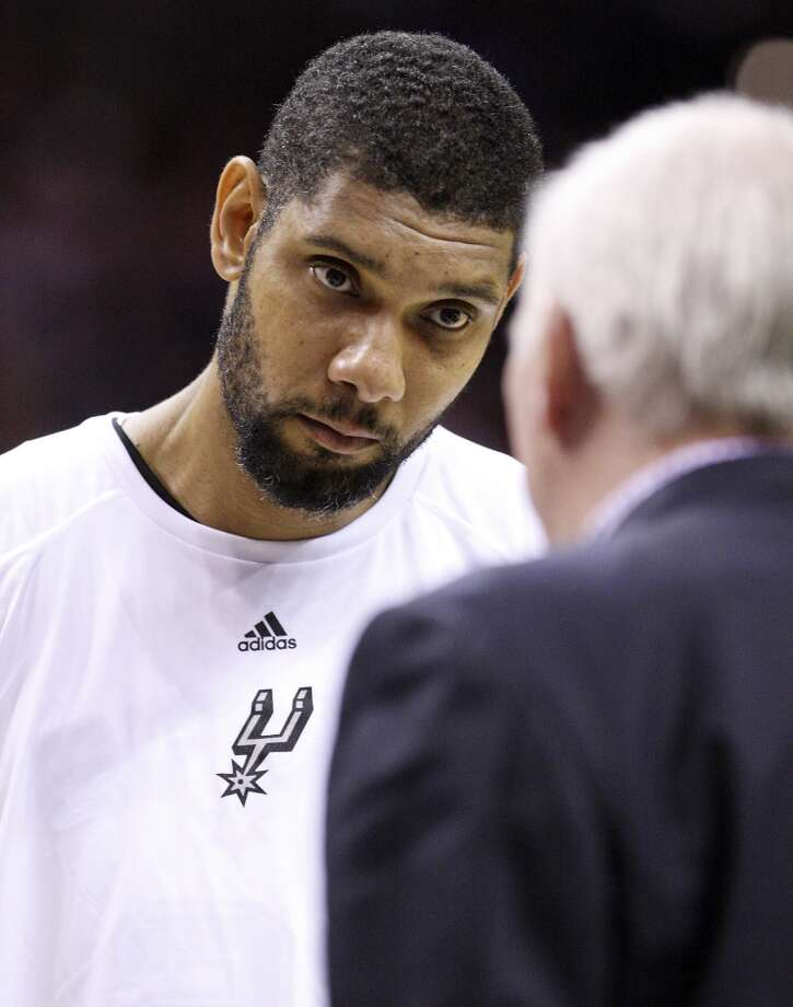 San Antonio Spurs' Tim Duncan listens to head coach Gregg Popovich during a timeout in first half action against Montepaschi Siena Saturday Oct. 6, 2012 at the AT&T Center.