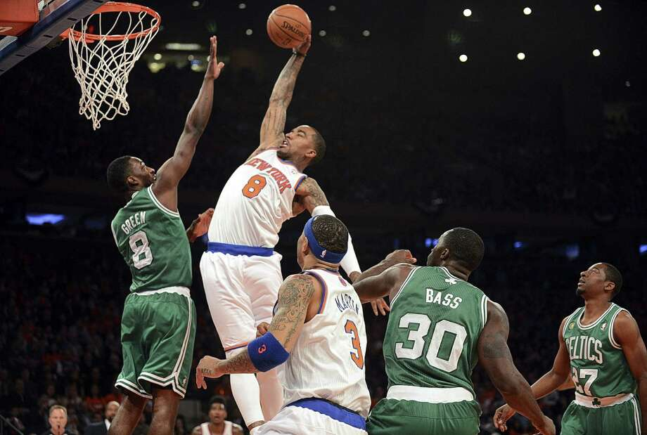 Knicks guard J.R. Smith goes up for two of his 15 points against Celtics forward Jeff Green on Saturday at Madison Square Garden. Green led the Celtics with 26 points. Photo: Barton Silverman / New York Times