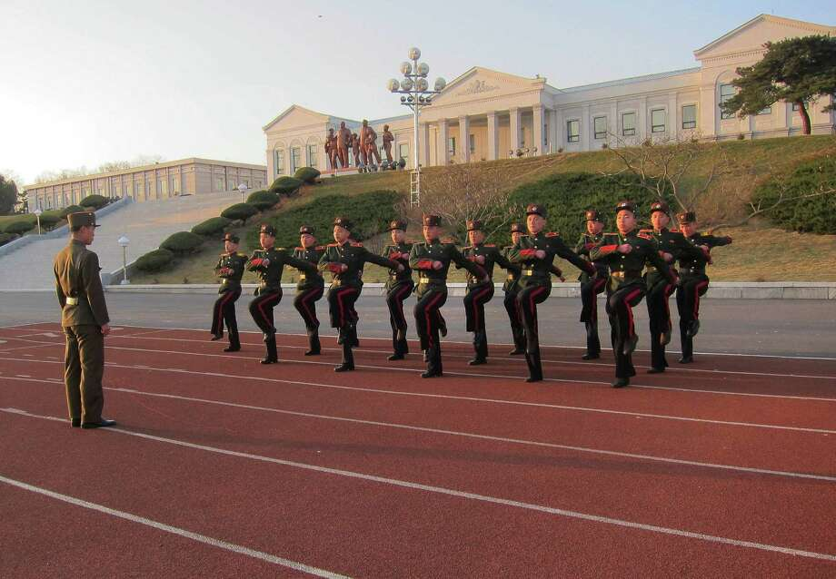 Students march in place Thursday at a military school in Pyongyang, North Korea, that originally was set up in 1947 for children whose parents died during Korea's fight for liberation from its Japanese occupiers. Photo: STF / AP