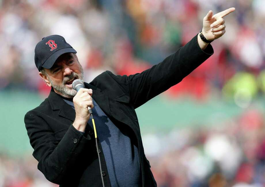"Neil Diamond sings '""Sweet Caroline"" during the eighth inning of a baseball game between the Boston Red Sox and the Kansas City Royals in Boston, Saturday, April 20, 2013. (AP Photo/Michael Dwyer) Photo: Michael Dwyer"