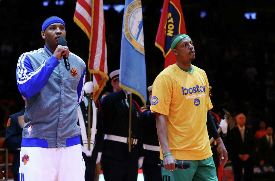 NEW YORK, NY - APRIL 20:  Carmelo Anthony #7 of the New York Knicks and Paul Pierce #34 of the Boston Celtics address the fans before Game One of the Eastern Conference Quarterfinals of the 2013 NBA Playoffs on April 20, 2013 at Madison Square Garden in New York City. NOTE TO USER: User expressly acknowledges and agrees that, by downloading and/or using this photograph, user is consenting to the terms and conditions of the Getty Images License Agreement.  (Photo by Elsa/Getty Images) Photo: Elsa