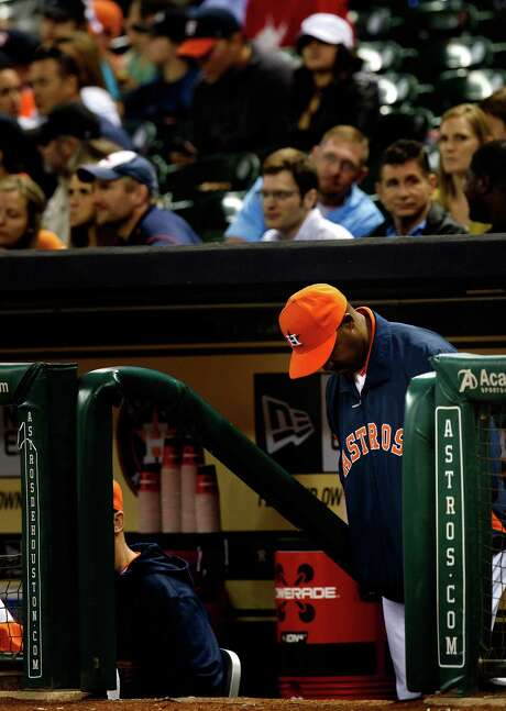Manager Bo Porter can't bear to watch as the Astros fall behind by eight runs in the first inning of a rout. Photo: Cody Duty, Staff / © 2013 Houston Chronicle