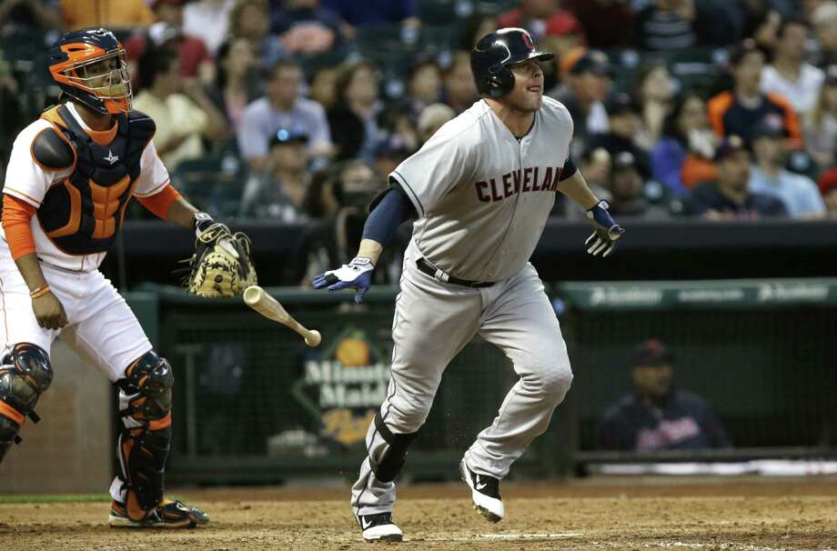 Cleveland's Jason Giambi tosses his bat after connecting on a three-run homer in the fourth inning Saturday in Houston. He had five RBIs in the win. Photo: Pat Sullivan / Associated Press