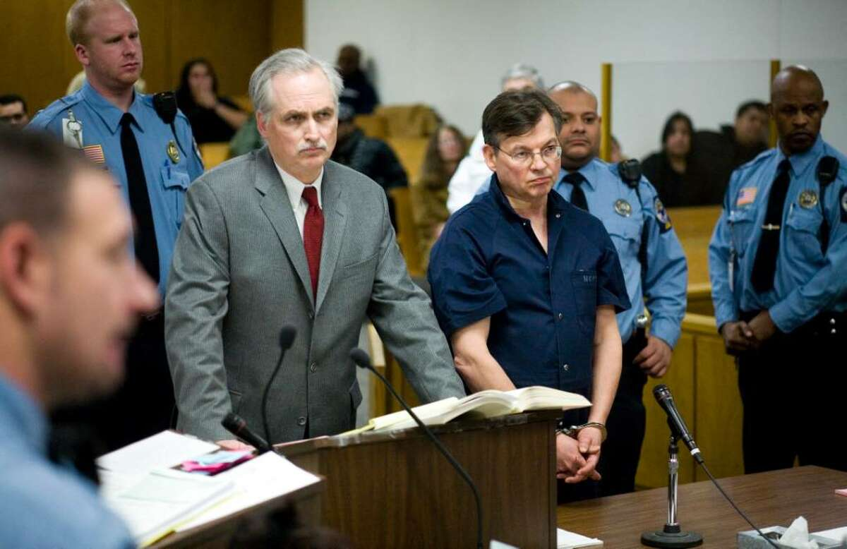 John Michael Farren of New Canaan, center right, is arraigned in state Superior Court in Norwalk Thursday after he was charged with attempted murder and strangulation following a report of a domestic dispute shortly after 10 p.m. At center left is his attorney, Eugene Riccio.