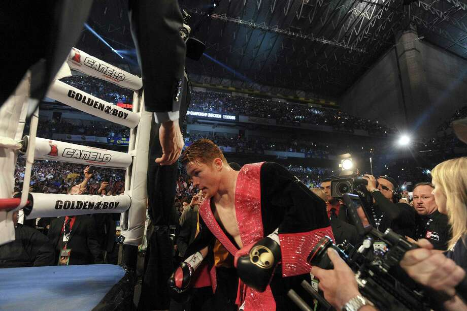 "Saul ""Canelo"" Alvarez enters the ring for his 154-pound boxing title unification bout against Austin Trout in the Alamodome on Saturday, April 20, 2013. Photo: Billy Calzada, Express-News / San Antonio Express-News"
