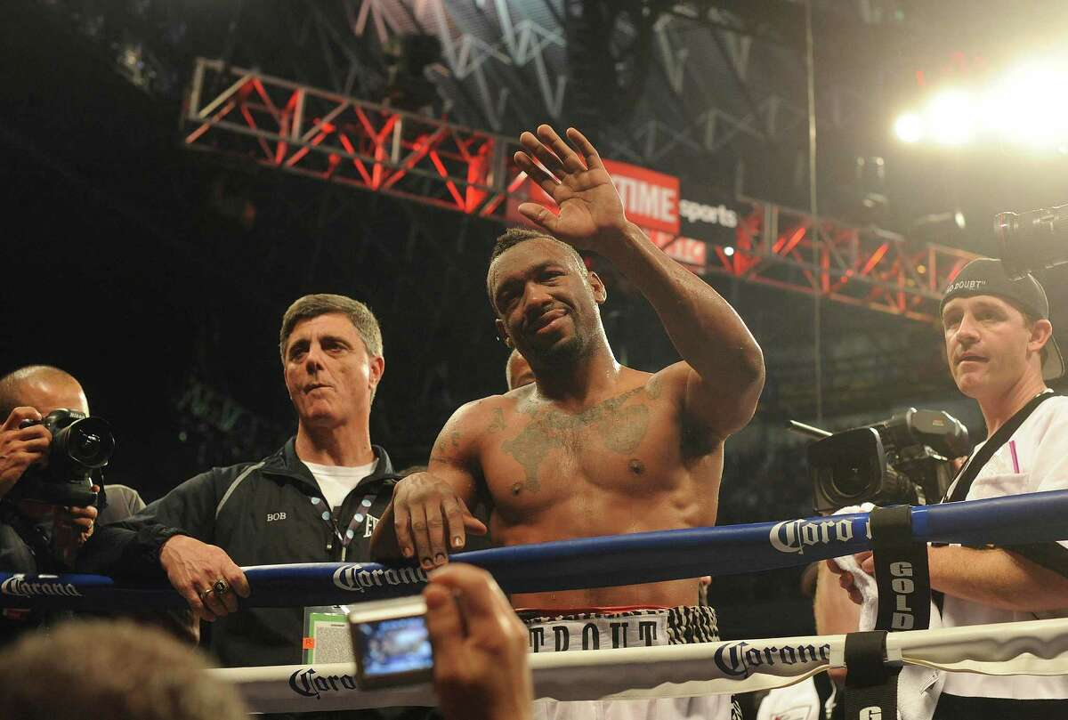 Austin Trout gestures to his family, saying