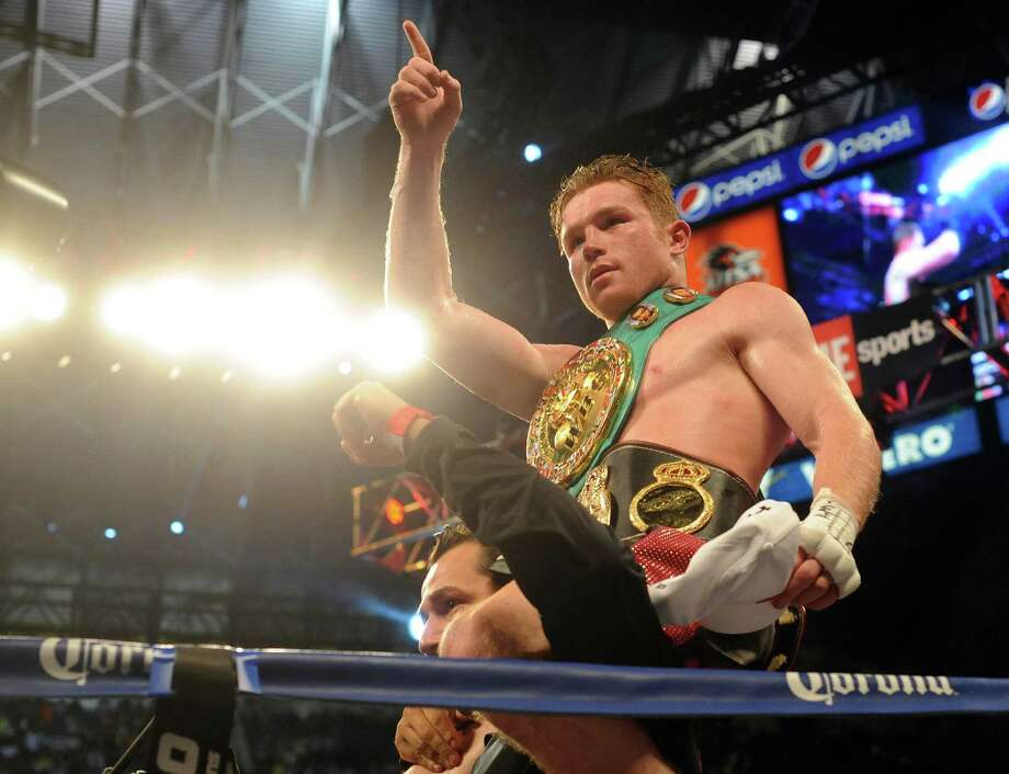 "Saul ""Canelo"" Alvarez is carried around the ring after defeating Austin Trout by unanimous decision in their 154-pound boxing title unification bout in the Alamodome on Saturday, April 20, 2013. Photo: Billy Calzada, Express-News / San Antonio Express-News"