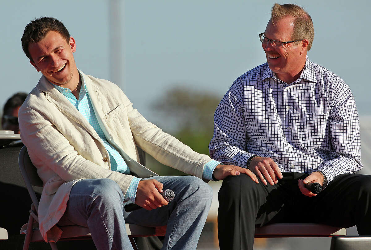 Heisman Trophy winner Johnny Manziel gets a laugh out of old stories from his high school coach, Mark Smith during a homecoming in Antler Stadium in Kerrville on April 20 2013.