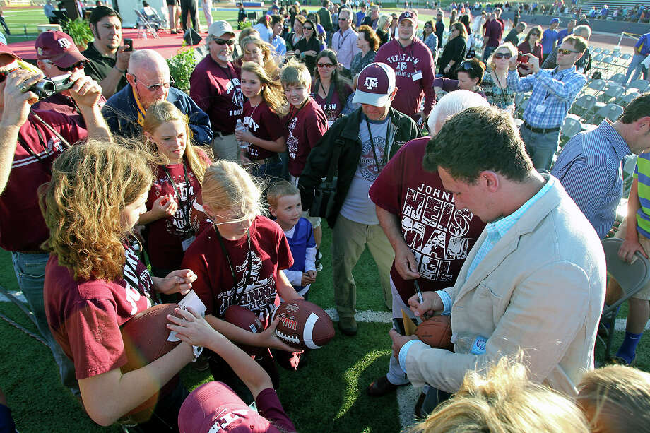 Heisman Trophy winner Johnny Manziel signs autographs after he is is celebrated at a homecoming in Antler Stadium in Kerrville on  April 20 2013. Photo: TOM REEL, Express-News
