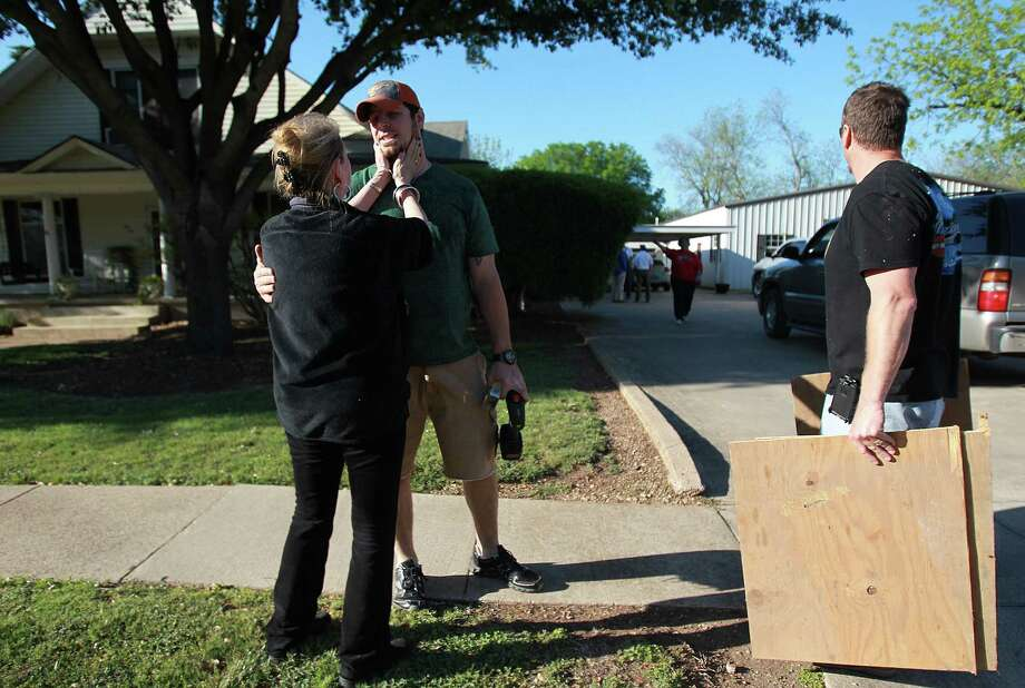 Mimi Montgomery Irwin thanks Matt Pavlicek, who lives in Sugar Land, as he gets ready to board up her broken windows on Saturday, April 20, 2013, in West. Authorities are starting the re-entry process in phases, and this afternoon Phase I began by allowing residents into parts of West less devastated. Photo: Mayra Beltran, Houston Chronicle / © 2013 Houston Chronicle