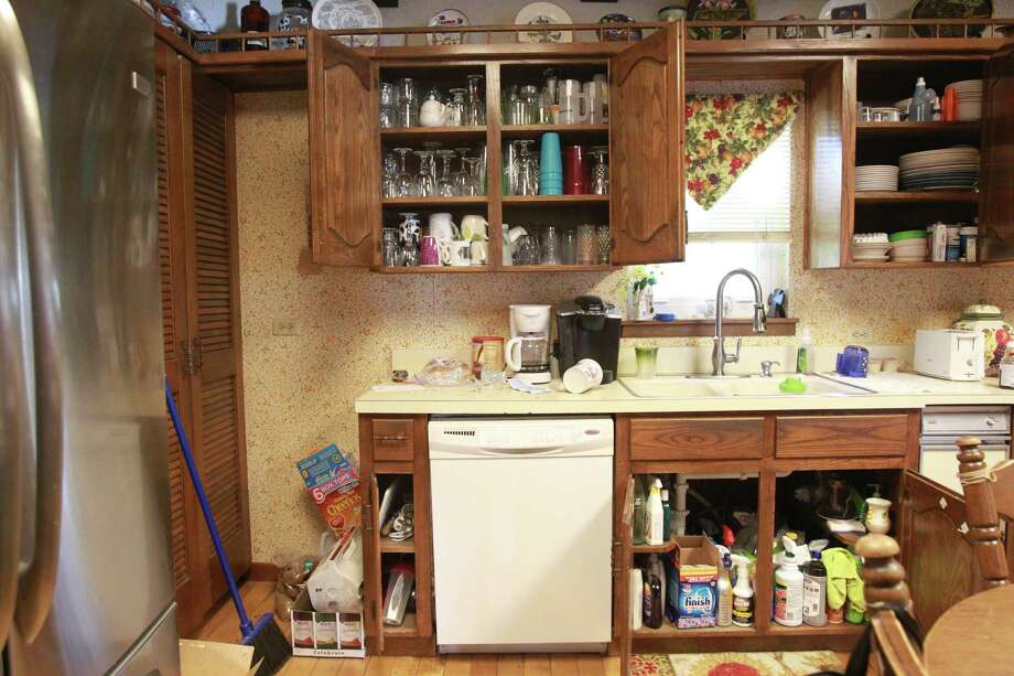 The doors of cabinets were blown open by plant explosion, and the Pavlicek Family found their kitchen just like they had left it on Saturday, April 20, 2013, in West. Authorities are starting the re-entry process in phases, and this afternoon Phase I began by allowing West residents into their homes. Photo: Mayra Beltran, Houston Chronicle / © 2013 Houston Chronicle