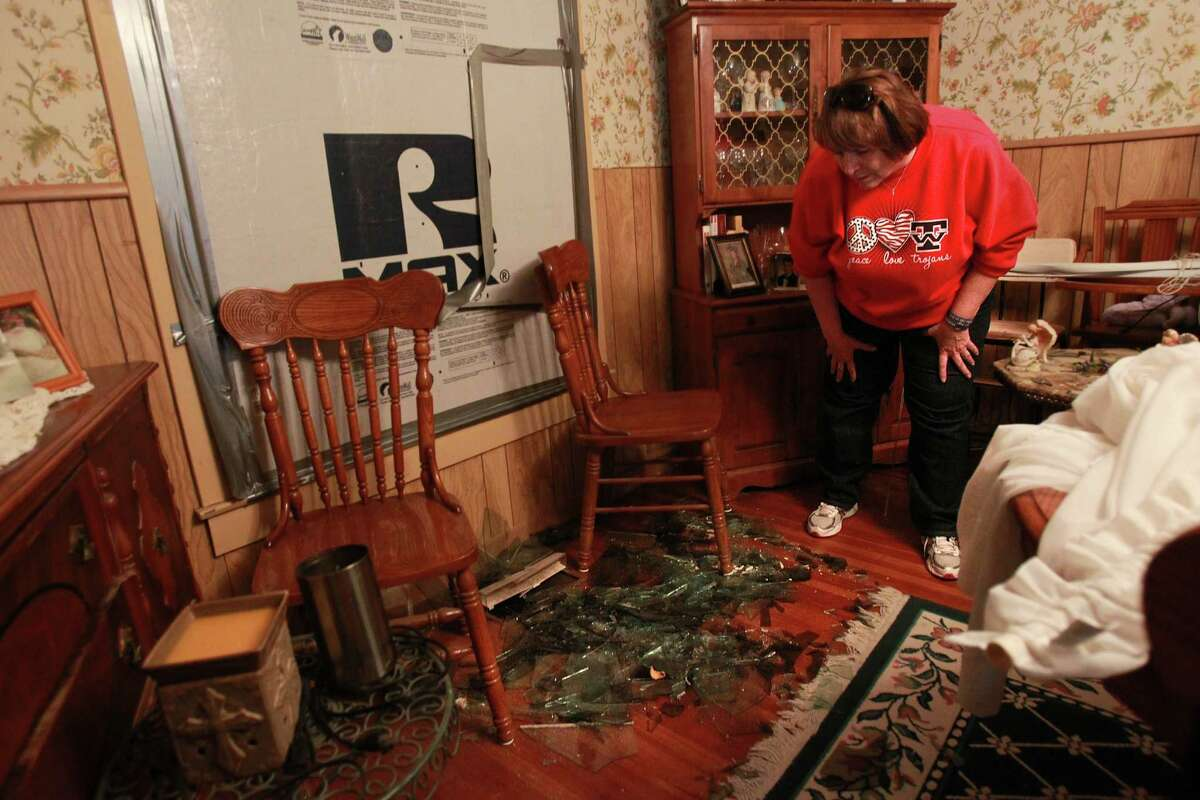 On Saturday, Debbie Pavlicek returns to her home after the explosion to see window glass all over the floor.