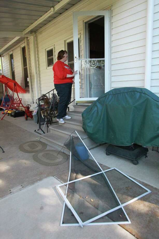 The screen and glass were blown off the back door from Debbie Pavlicek's home on Saturday, April 20, 2013, in West. Authorities are starting the re-entry process in phases, and this afternoon Phase I began by allowing residents into parts of West less devastated. Photo: Mayra Beltran, Houston Chronicle / © 2013 Houston Chronicle