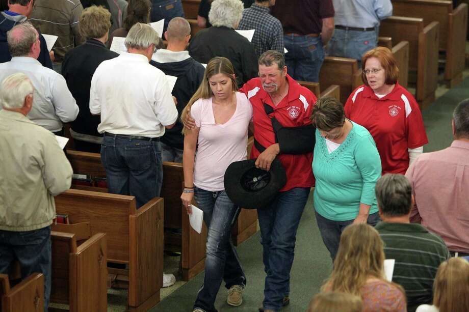 Community members weep at the service. Photo: Mayra Beltran, Houston Chronicle / © 2013 Houston Chronicle