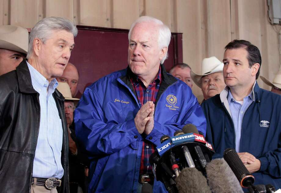 Congressman Roger Williams, left, speaks with reporters about the West, Texas fertilizer plant explosion as Senators John Cornyn and Ted Cruz listen at a news conference on Friday April 19, 2013.   The massive explosion at the West Fertilizer Co. Wednesday night killed as many as 15 people and injured more than 160. The bodies of 12 people have been recovered, authorities said Friday. (AP Photo/Star-Telegram, Ron T. Ennis) Photo: RON T. ENNIS, Associated Press / The Fort Worth Star-Telegram