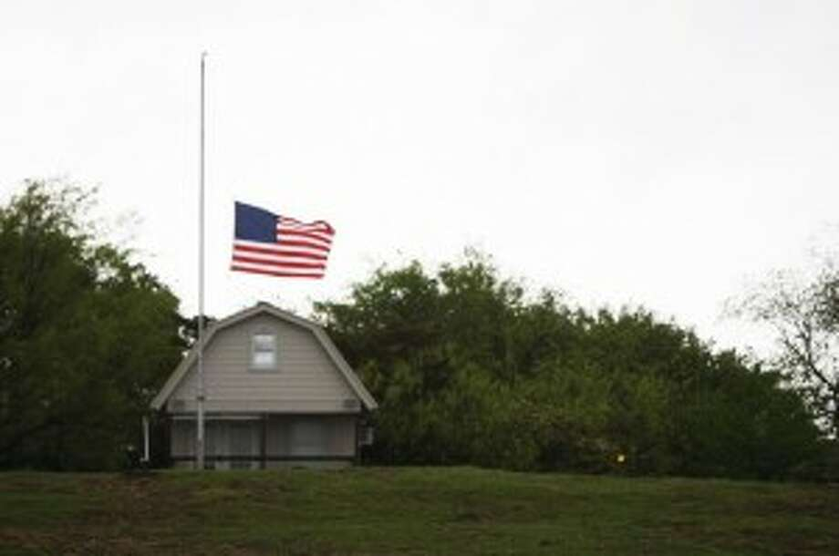 A flag at half mast after the explosion at a West, Texas fertilizer plant. (Chronicle/ Johnny Hanson)