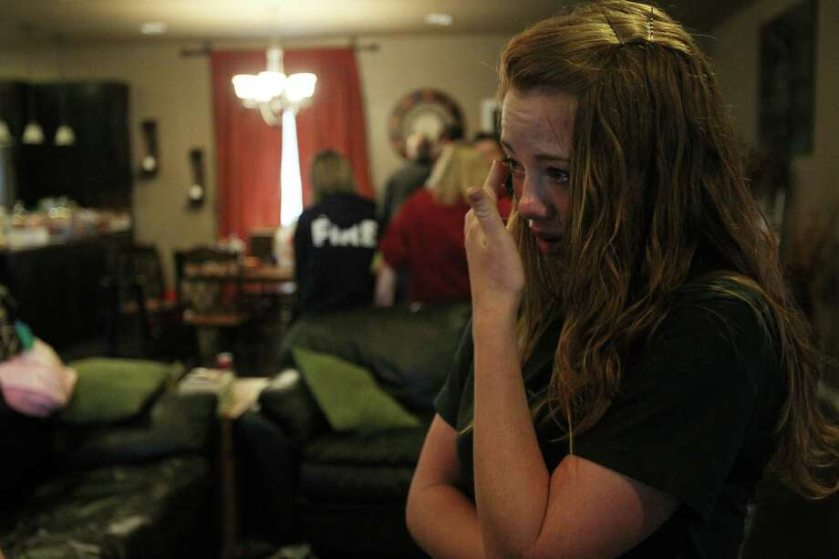 Dusty Uptmor, daughter of victim Buck Uptmor, cries as she talks about her father on Friday in West.  Photo: Mayra Beltran, Houston Chronicle / © 2013 Houston Chronicle