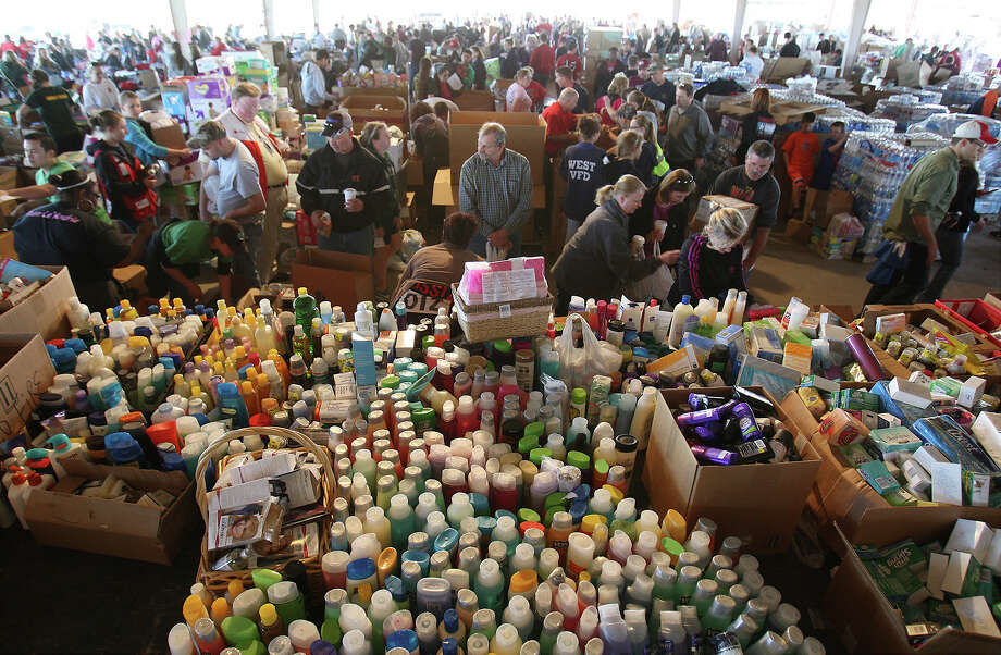 Supplies of toiletry are put out for people to pick up at a distribution center to help those affected from the West Fertilizer explosion in West, Texas on Friday, Apr. 19, 2013. Photo: Kin Man Hui, San Antonio Express-News / ©2013 San Antonio Express-News