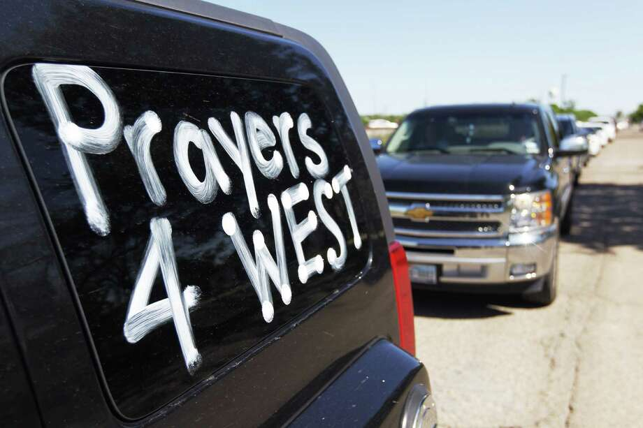 Message supporting West can be seen on this car.  Photo: Johhny Hanson/ Houston Chronicle