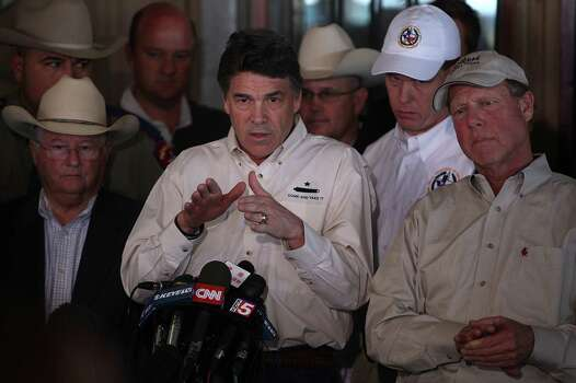 Texas Gov. Rick Perry was among the officials at the devastated town Friday. Photo: Mayra Beltran, Staff / © 2013 Houston Chronicle